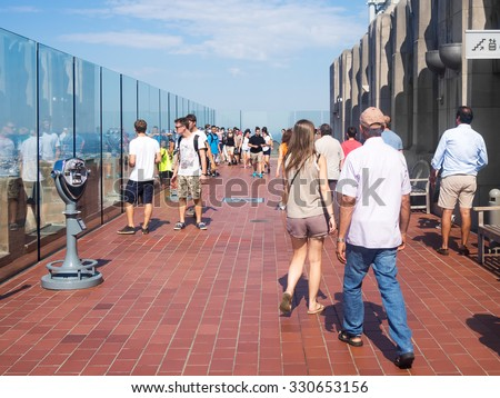 NEW YORK,USA - AUGUST 15,2015 : Tourists at the Top of the Rock observatory atop the GE Building, part of the Rockefeller Center - stock photo