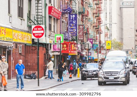 NEW YORK, USA - AUGUST 23, 2014: View of a street and buildings in China Town district. All signs and writings are written with chinese characters. - stock photo