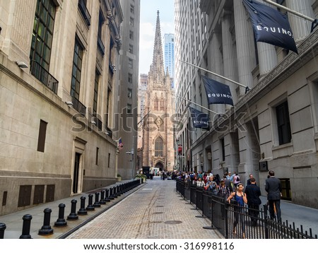NEW YORK,USA - AUGUST 13,2015 : View of Wall Street and Trinity Church in New York - stock photo