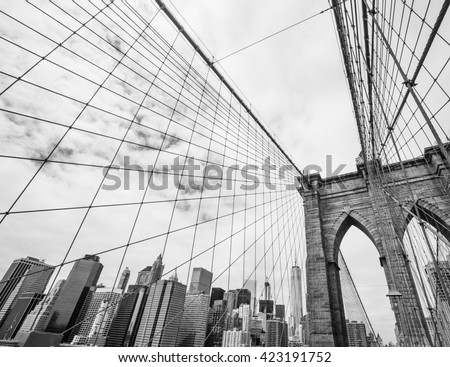 New York, USA. Black and white image of Brooklyn bridge and Manhattan from the East river.  - stock photo