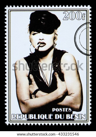 NEW YORK, USA - CIRCA 2010: A postage stamp printed in the Republic of Benin showing Madonna Louise Ciccone, circa 2002 - stock photo