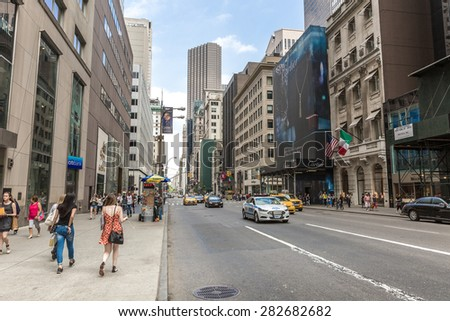 NEW YORK, USA - CIRCA MAY 2015: Pedestrians and Vehicles move along 5th Avenue in New York City. - stock photo