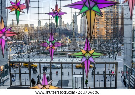 New York, USA - December 27, 2014: Columbus Circle from Time Warner Center with Christmas Decorations in foreground. In the heart of Manhattan, TWC is a place to dine, shop, work and be entertained. - stock photo