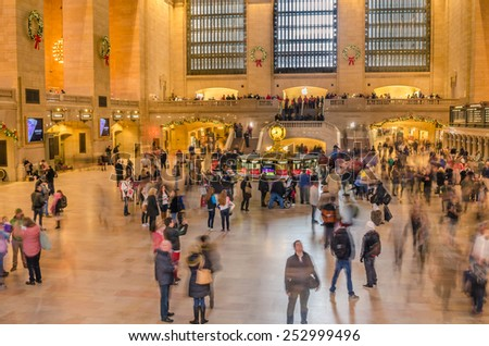 New York, USA - December 28, 2014: Main Concourse of Grand Central Terminal crowded with people during the Christmas Holidays. GCT is the largest station in the world by number of platforms with 44. - stock photo