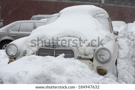 NEW YORK, USA - FEB 16:A sixties Mercedes Benz luxury car buried under layers of snow during severe snow storm on February 16, 2014 in New York, USA