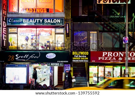 NEW YORK, USA - FEBRUARY 4: multinational immigrant's stores in New York at night on February 4, 2010. 36% of the population of New York City are immigrants and they speak as many as 800 languages. - stock photo