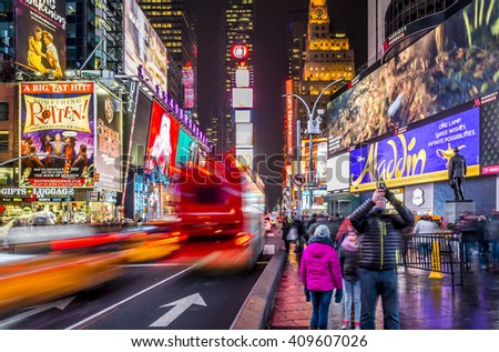 NEW YORK, USA - FEBRUARY 12: The modern architecture of the famous Times Square in New York city, USA with its neon lights at night with a lot of tourists and locals passing by on February 12, 2016.