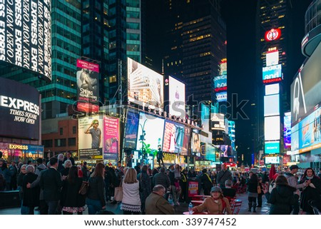 NEW YORK,USA-JULY 3,2015:New York Times Square night scenes featuring the crowd and neon ads. The tourist landmark is visited by about 50 million tourists every year