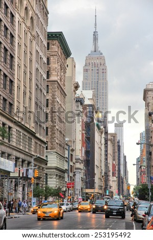 NEW YORK, USA - JULY 3, 2013: People visit 5th Avenue, Midtown Manhattan in New York. Almost 19 million people live in New York City metropolitan area. - stock photo