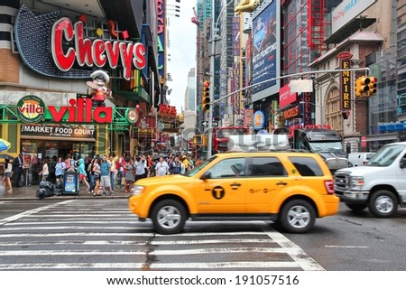 NEW YORK, USA - JULY 1, 2013: People visit Times Square in New York. Times Square is one of most recognized landmarks in the world. More than 300,000 people pass through Times Square daily.