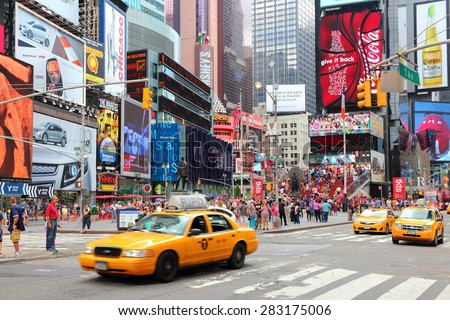 NEW YORK, USA - JULY 4, 2013: People visit Times Square in New York. Times Square is one of most recognized landmarks in the world. More than 300,000 people pass through Times Square daily. - stock photo