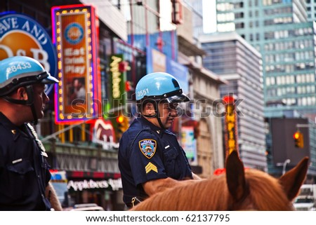 NEW YORK, USA - JULY 7: police officers ride their horses downtown in New York on the main street, Manhattan on  July 7,2010, New York, USA - stock photo