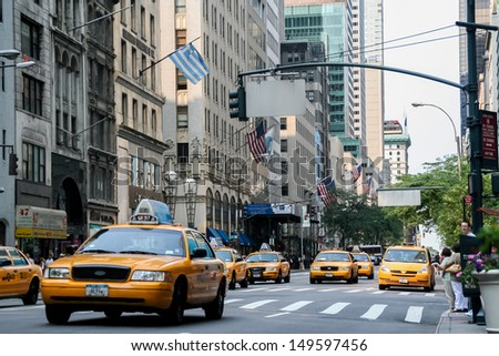 NEW YORK, USA - JULY 13: Taxi cabs on the street of New York City at July 13, 2008. There is 13,237 taxi cabs operating in New York City which have 241 million annual taxi passengers.