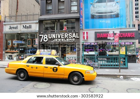 NEW YORK, USA - JULY 4, 2013: Taxi drives in Diamond District along 47th street in New York. This area is one of world's major diamond industry centers. - stock photo