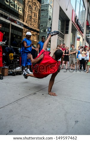 NEW YORK, USA - JULY 13: Unknown dancer in the street of New York at July 13, 2008. Street performers in New York only need a permit to perform if they have amplified sound. - stock photo