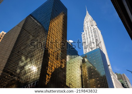 NEW YORK, USA - Jun 01, 2014: Chrysler building and manhattan modern architecture. Manhattan is the most densely populated of the five boroughs of New York City - stock photo