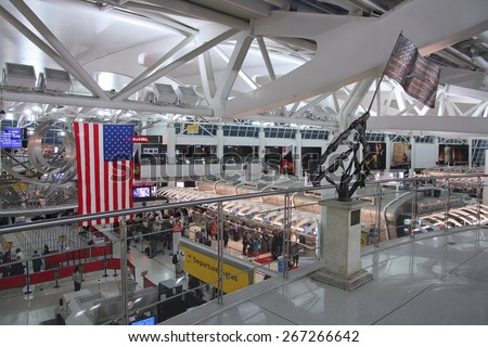 NEW YORK, USA - JUNE 7, 2013: People hurry at JFK Airport in New York. In 2012, the airport handled 49.3 million passengers (6th busiest in the United States). - stock photo