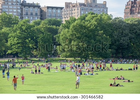 NEW YORK - USA - 14 JUNE 2015 people is spending time amusing in central park on sunny sunday - stock photo
