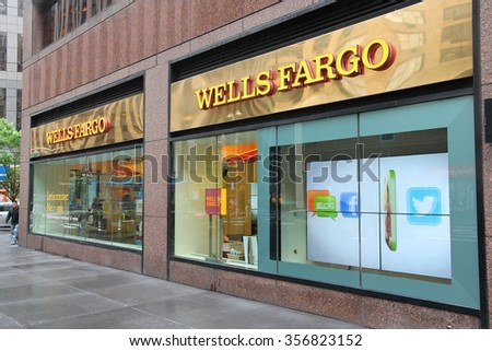 NEW YORK, USA - JUNE 10, 2013: People walk by Wells Fargo Bank branch in New York. Wells Fargo was the 23rd largest company in the United States in 2011 (by revenues).
