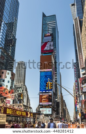 New York, USA - June 18, 2016: Times Square during the day with advertisements, pedestrians and stores - stock photo