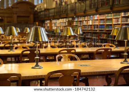 NEW YORK, USA - MARCH 14: Detailed light on table in the historical Rose Main Reading Room in New York Public Library NYPL , on March 14, 2014 in New York, USA. - stock photo