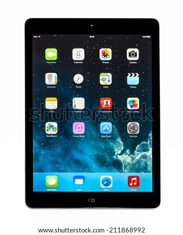 New York, USA - May 27, 2014: Apple iPad mini displaying iOS 7.1 homescreen. iOS 7.1 operating system designed by Apple Inc. official output 10 March 2014. iPad mini is a tablet produced by Apple Inc. - stock photo