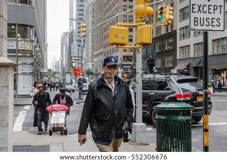 NEW YORK, USA - May 03, 2016: Madison avenue in NYC. Manhattan street scene. Americans are in a hurry about their business.