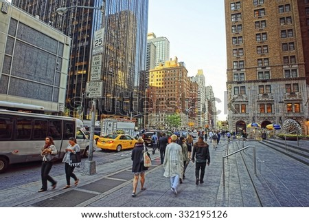 NEW YORK, USA - MAY 06, 2015: People walk along 6th Avenue in New York City, USA. Sixth Avenue is a major thoroughfare in NYC's borough of Manhattan. It's commercial for much of its length - stock photo