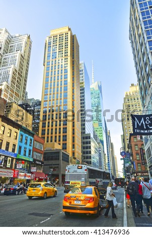 New York, USA - May, 6, 2015: Street In Midtown Manhattan in New York City, USA. Tourists passing by