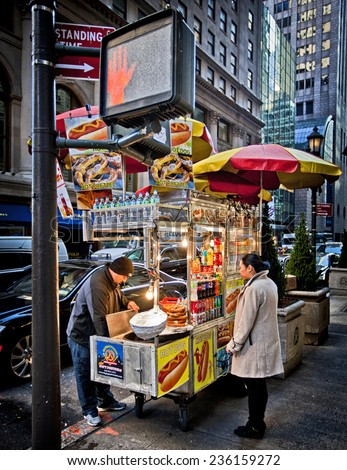 NEW YORK, USA - NOVEMBER 13th, 2014: Food cart vendors can be found all over the streets of midtown Manhattan providing hot dogs and snacks - stock photo