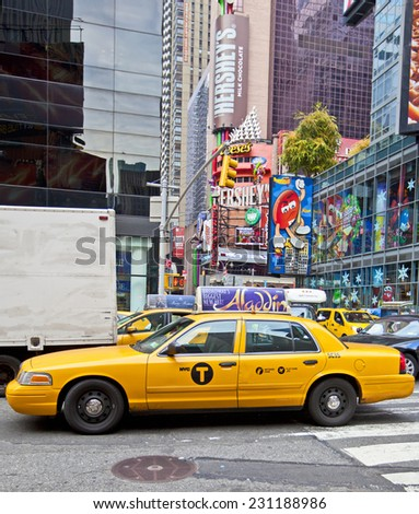 NEW YORK, USA - NOVEMBER 13th, 2014: Traffic driving through New York's famous Times Square area with colorful signage. - stock photo