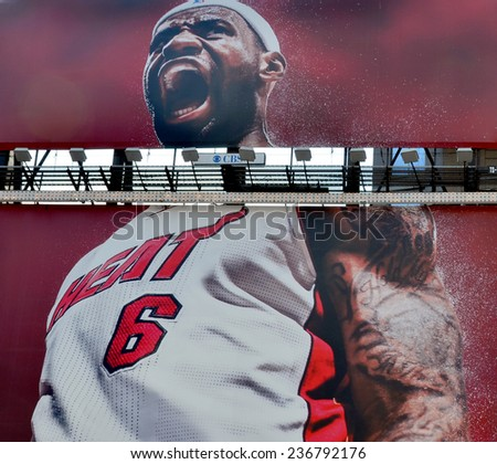 NEW YORK USA OCTOBER 27: Giant sign of Lebron James in Time Square on October 27, 2013 in New York, LeBron Raymone James is an American professional basketball player with the Cleveland Cavaliers