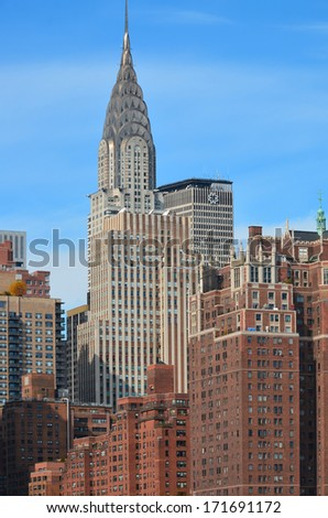 NEW YORK USA OCTOBER 27:Midtown and Chrysler building facade on October 27, 2013 in New York, was the world's tallest building before it was surpassed by the Empire State Building in 1931. - stock photo