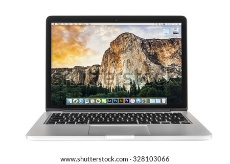New York, USA - October 13, 2015: Studio shot of brand new Apple MacBook Pro with Retina Display, designed and developed by Apple inc. - stock photo