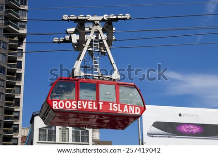 NEW YORK, USA-OCTOBER 9, 2014: The famous Roosevelt Island cable tram that connects Roosevelt Island to Manhattan Uptown. Each cabin has a capacity of up to 110 people and makes app 115 trips per day - stock photo