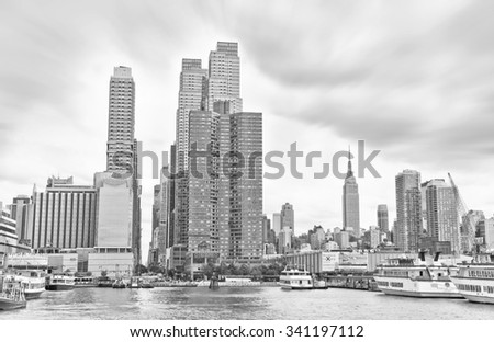 New York, USA - October 9, 2013: View of Manhattan in a cloudy day at Hudson shore in New York City on October 9, 2013.  - stock photo