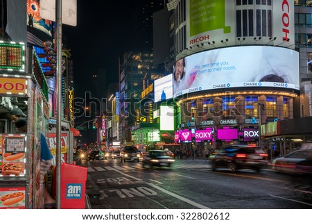 New York, USA on 2nd Sept 2015: Times Square is a major commercial intersection and neighborhood in Mid Manhattan at the junction of Broadway and Seventh Avenue, stretching from W 42nd to W47th Street - stock photo