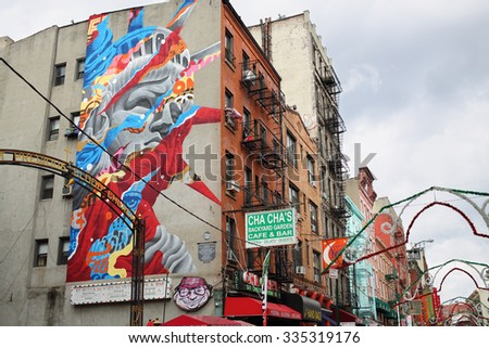 NEW YORK, USA - SEP 08, 2014:  Color portrait of the Statue of Liberty on a building in Chinatown in New York - stock photo