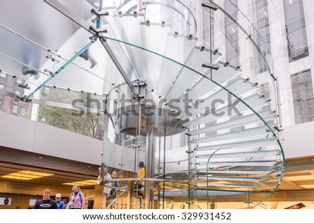 NEW YORK, USA - SEP 22, 2015: Glass stairs at the Apple store on the Fifth Avenue, New York. The store sells Macintosh personal computers, software, iPod, iPad, iPhone, Apple Watch, Apple TV - stock photo