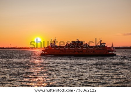 NEW YORK, USA - SEP 08, 2017: Manhattan South Ferry Boat Staten Island Sunset