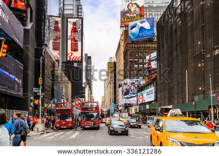 NEW YORK, USA - SEP 22, 2015: Touristic red bus at the Times Square, a major commercial neighborhood in Midtown Manhattan, New York City - stock photo