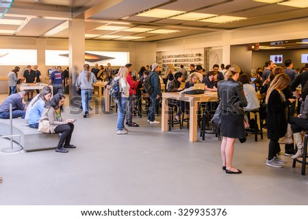 NEW YORK, USA - SEP 22, 2015: Unidentified people in the Apple store on the Fifth Avenue, New York. The store sells Macintosh personal computers, software, iPod, iPad, iPhone, Apple Watch, Apple TV - stock photo