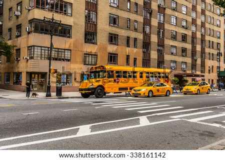 NEW YORK, USA - SEP 22, 2015: Yellow school bus on the Eighth avenue (Manhattan). 8 avenue begins in the West Village neighborhood at Abingdon Square
