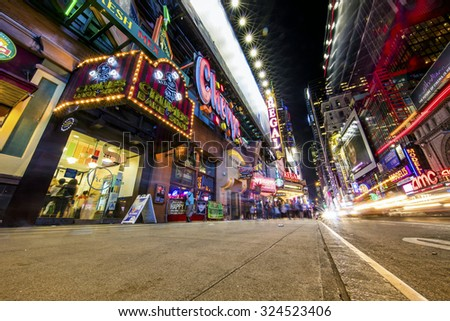NEW YORK, USA - Sept 18th, 2015: Times Square and 42nd Street is a busy tourist intersection of neon art and commerce and is an iconic street of New York and America - stock photo
