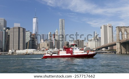 NEW YORK, USA - SEPT 28, 2014: The fire boat No.343 on East River. Named in honor of the 343 FDNY members killed on Sept. 11, 2001, and with steel on the bow and stern from the World Trade Center. - stock photo