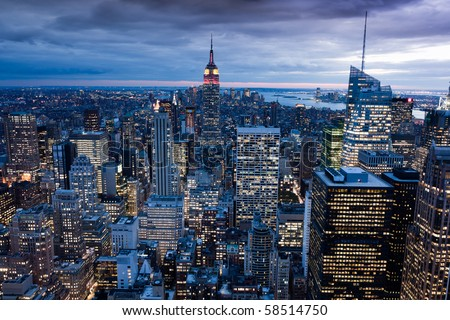 NEW YORK, USA - SEPT 30: View on Manhattan and Empire State Building illuminated red and yellow in honor of the 60th anniversary of  People´s Republic of China on September 30, 2009 in New York. - stock photo