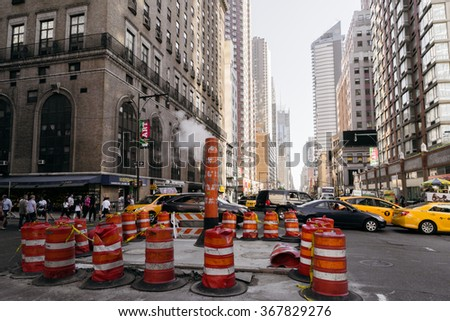 New York, USA - September 20, 2015: A steam chimney of New York City in the streets of the city. - stock photo