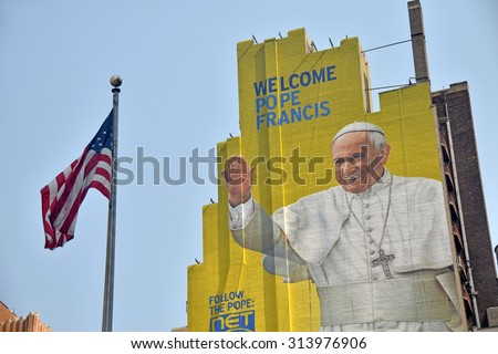 New York, USA - September 3, 2015: Giant outdoor mural greets visitors and locals in New York City dedicated to the Pope's visit in 2015 - stock photo
