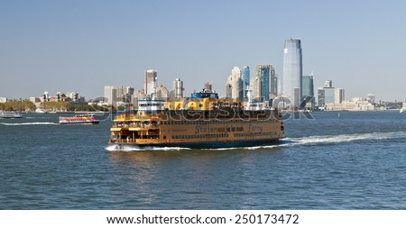 NEW YORK, USA, SEPTEMBER 27, 2014: Staten Island Ferry provides 22 mill people a year (70,000 passengers a day) with service between St. George on Staten Island and Whitehall Street in lower Manhattan - stock photo