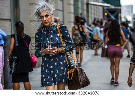New York. Usa - September 8, 2014: Stylish old lady with a bag of Louis Vuitton after the Marc Jacobs show at Fashion Week in New York. Street style photo - stock photo